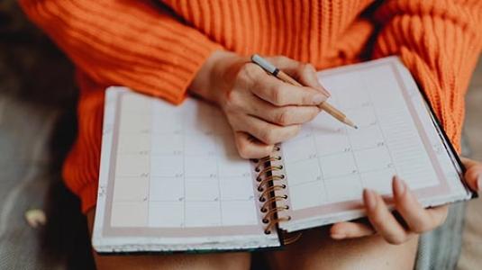 girl writing in calendar