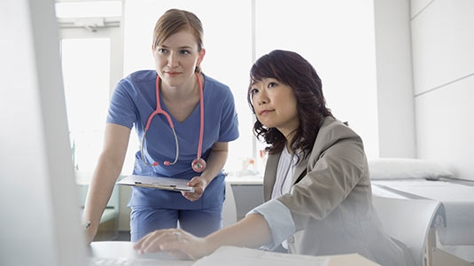 doctor and administrator consult